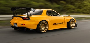 HEADLINER: GOLD PLATED RE-AMEMIYA RX-7